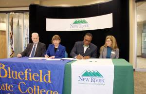 Leaders from Bluefield State College and New River Community and Technical College signed an articulation agreement Thursday at Raleigh County Campus: Dr. Larry Conner (left), Bluefield State College Interim Vice President for Academic Affairs; Dr. Marsha Krotseng, Bluefield State College President; Dr. L. Marshall Washington, New River CTC President and Dean Maryanne Layer, New River CTC Dean of Transfer and Pre-Professional Programs.