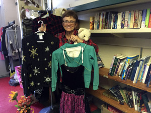 Jo Long holding some items from the Thrift Shop