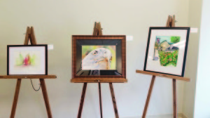 "Greenbrier Valley Visitors Center welcomes Artist Diane Mitchell An adorable pig with winsome eyes and a lonely truck are two of the watercolor images created by Diane Mitchell.  She is the latest artist to be featured in the Art in the Valley exhibit at the Greenbrier Valley Visitors Center. Meet Diane when ""Color Obsessed"" opens at First Fridays after Five on Nov. 6.  Strum Sum Band will provide musical entertainment and HospiceCare will have tickets available for their annual ""Toast to Hospice"" event.  For more information about the Greenbrier Valley Visitors Center activities, please contact Kristi Godby, Media Relations Manager, at kgodby@greenbrierwv.com or call 304-645-1000."