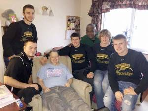 GEHS football players visit The Brier Approximately 30 football players from the Greenbrier East football team visited The Brier, a nursing home in Lewisburg, Monday morning, Dec. 21. They took time to talk to each resident, and gave them all a small gift. In this photo, resident John Hylton is surrounded by football players Billy Honaker (left, standing), and Devin Persinger (left to right), Colby Johnson, Coach Ray Lee, Jared Wylie and Jonathan Carr. Lee said this is an annual tradition, and the team has made this visit several times, just before Christmas each year. (Photo by Mark Robinson)