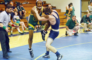 Greenbrier East's Leslie Campbell (left) attempts to free his leg from the grip of Greenbrier West's Cameron Hunter, in a contest held at Greenbrier West's gym in Charmco, Tuesday, Dec. 29. (Photo by Mark Robinson)