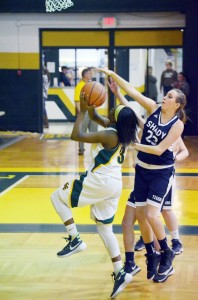 Greenbrier East's Kiara Smith drives past Shady Spring's Morgan Brown during the first quarter of a game played at the Greenbrier East gym, Tuesday, Jan. 5. Photo by Mark Robinson.