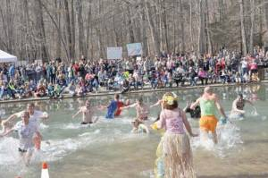 A large crowd cheers on participants at the 2014 Greenbrier Polar Bear Plunge. Each year plungers come to Blue Bend and jump in to raise funds and awareness to combat child abuse.