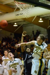 Levi Massey, #33, playing under the basket for Greenbrier East High School, blocks a shot by Bluefield's Jaray Williams, #5, in a game played at the Spartan gym, Friday, Feb. 19. Bluefield won the game 64-47. (Mark Robinson photo)
