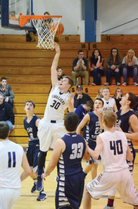 J. Oxendine, #30, of the Greenbrier West Cavaliers goes up in the middle of a pack of Clay-Battelle defenders for a basket. The game was played in Charmco Thursday evening, Jan. 28. Greenbrier West won the game 66-36. Oxendine had 13 points. (Photo by Mark Robinson)