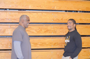 Bound for Morgantown Zayvion Lawson (right) and his high school coach Ray Lee, share a little humor in the gym of Greenbrier East High School. Lawson has announced he will further his football career with the WVU Mountaineers. (Mark Robinson photo)