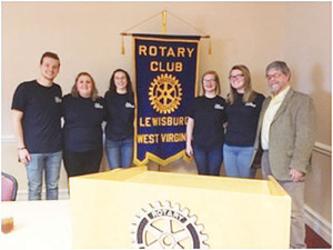 """Shown with Rotary Club Liaison Jan Westerik are GEHS GoGlobal-Interact officers: Caleb Warden Zoe Sampson, Abigail Plum, Emily McClung and Jade Napier. Through student presentations Rotary members learned about the varied activities conducted at Greenbrier East in service to local and international causes. As an Interact club, GEHS GoGlobal embraces the Rotary model of """"Service Above Self."""" Students connect with community leaders, develop leadership skills, make international connections and prepare to be the next generation of engaged community leaders."""