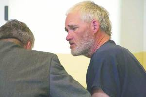 Ivan Dennings Cales confers with his attorney last year during his arraignment in Taos, NM. (Rick Romancito photo)