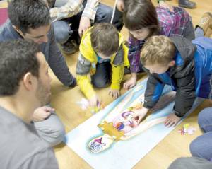 WVSOM volunteers helped kids put together a human anatomy puzzle in order to learn about different internal organs, where they are located in the body and what they do. (Photo courtesy of Pat Bauserman, WVSOM)