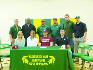 Greenbrier East High School senior Colby Johnson signed to play baseball at the University of Charleston next year. Pictured at the signing are: Front Row: Ashley Johnson (left), April Davis, Colby Johnson and Sam Johnson; Back Row: Ben Routson, athletic director (left), Head Football Coach Ray Lee, Head Baseball Coach Cory Mann, Assistant Baseball Coach Scot Brown,  Assistant Football Coach Jared Sams and Travis McClintic, physical therapist. (Photo by Mark Robinson)
