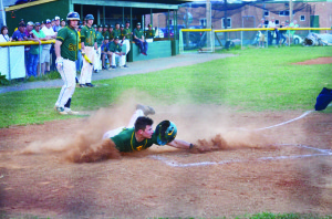 Colby Johnson slides home to score the third run of a 13-3 Spartan victory over the visiting Princeton Tigers, Monday, Apr. 18. (Mark Robinson photo)