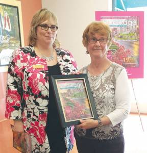 """As part of National Tourism Week kick-off campaign, the staff at the Greenbrier County CVB visitors center hosted a celebratory event for Connie Manchester in honor of her stunning photograph of downtown Lewisburg, which was selected as the cover image of the May/June edition of Blue Ridge Country magazine,  that highlighted Lewisburg, voted """"Happiest Mountain Town."""" Also honored was her spouse, Mayor John Manchester, for his full-page guest column in the bi-monthly publication. Pictured is CVB Executive Director Kara Dense (left) with Connie Manchester. (Photo by Peggy Mackenzie)"""
