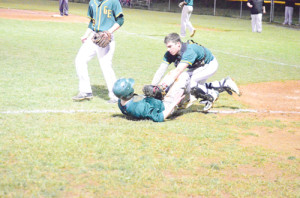Greenbrier East catcher Blake Colley (right) collides with Fayetteville's Braden Broach just a few feet from home plate. Broach was out on the play, the third out of the fifth inning, in a game played at East's field Wednesday evening. (Mark Robinson photo)
