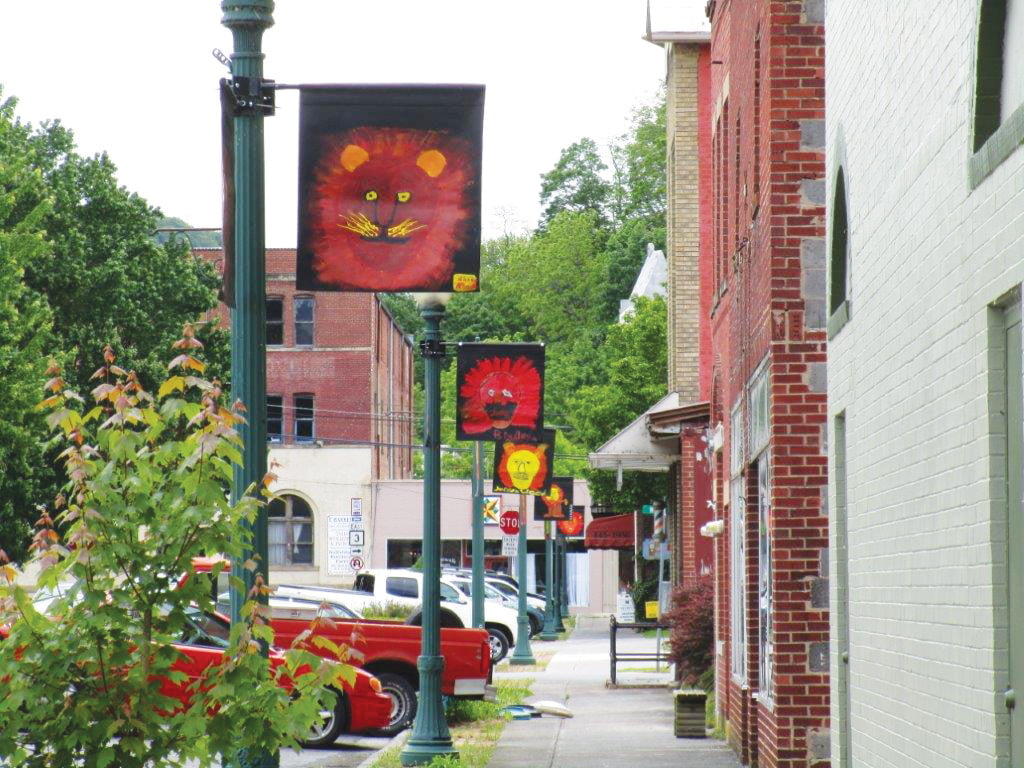 Lion flags on Railroad Avenue in the Historic Business District of Alderson.