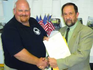 """Delegate George """"Boogie"""" Ambler (right) presents a Governor's Community Partnership Grant to Mayor Travis Copenhaver for the Town of Alderson."""