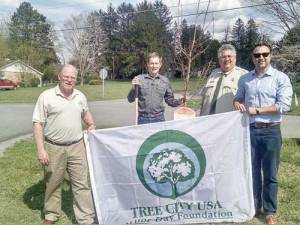 Lewisburg Mayor, John Manchester (left); Lewisburg Director of Public Works Roger Pence; Partnership Coordinator for the WV Division of Forestry, Andy Sheetz and Lewisburg Parks Commission Chairman Josh Baldwin.