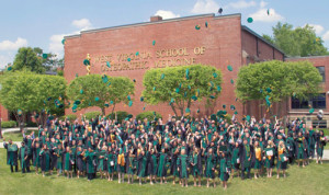 """WVSOM graduates participate in the annual """"Hat Toss"""" after the graduation ceremony."""