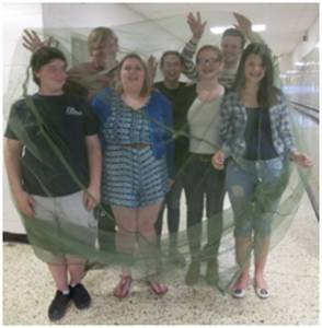 GEHS GoGlobal-Interact students prepare to sleep under an anti-malaria bed net for a week.