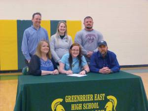 Makayla Carter of Greenbrier East High School has signed with Emory & Henry to play soccer. Front Row: Julie Carter, mother (left); Makayla Carter and Matt Carter, father; Back Row: Coach Hugh Clements-Jewery (left), Greenbrier East Head Coach Courtney Cole-Hudnall and Coach Shannon Shanklin.