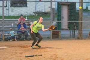 Meagan Slaven, playing catcher for the softball team sponsored by the Seneca Trail Animal Hospital, takes a throw from first base that stops a base runner at third base. The Animal Hospital Team played against the team Cleats and Cleavage in a game at Dorie Miller Park, Friday, June 3. (Mark Robinson photo)