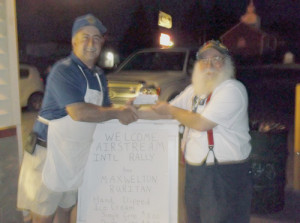 Classic Airstream Club President Joel Ware (right) of Seattle, Washington, presents a check for $200 to Ruritan member Larry Bowman (left) to support the Flood Relief Fund of the Maxwelton Ruritan Club.