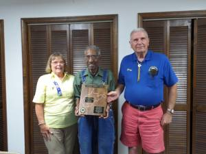 White Sulphur Springs Lions Frank Mosley (center) was presented West Virginia Lions' highest honor by outgoing President Connie McMichael and Past District Governor George Gillespie.