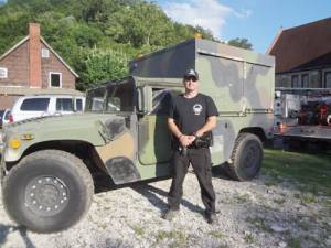 Alderson Police Chief Jeremy Bennett in his new Humvee, which he immediately put to use during the historic flooding June 23.