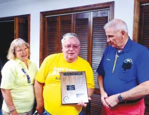 White Sulphur Springs Lions Roger Martin (center) was presented West Virginia Lions' highest honor by outgoing President Connie McMichael and Past District Governor George Gillespie.