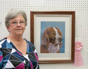 "Local artist Rose Dobbins has won top honors for best animal or bird painting at the Bath County Art Show.  The painting that garnered the award, a pastel of a Brittany spaniel, was a demonstration that she completed while painting in the window at the WV Fine Artisans Gallery, in Lewisburg, during July's First Friday celebration. In addition to the Bill and Prudence Fields Award, Dobbins also won third place for her pastel painting, ""The Dolly Sods."" Although pastels are her medium of choice, Dobbins also works in acrylics, watercolor and oils. She is currently offering classes in acrylics and pastels at the WV Fine Artisans Gallery. Dobbins is a member of Greenbrier Artists, a signature member of the West Virginia Watercolor Society, and a juried member of Tamarack. She is also one of a group of artisans that recently opened the WV Fine Artisans Gallery located Lewisburg at 951 W. Washington Street."
