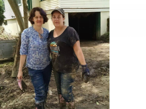 Shannon Beatty (left) and Chastity Patrick cleaning up their dad's home.