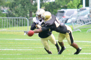 """A pass intended for wide receiver R.J. Harris (left) is broken up by Delvin Breaux, a 6'1"""" cornerback. Breaux did not play college football because of a neck injury, but spent three years playing in developmental league, in arena football, and in the Canadian Football League, before signing with the Saints in January of 2015. Harris is in his second year, out of New Hampshire. (Mark Robinson photo)"""