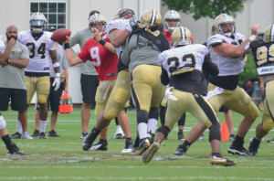 Drew Brees, quarterback for the New Orleans Saints, slings a sidearm pass to running back Mark Ingram during a practice Saturday. Brees has won numerous awards, and one Super Bowl, with the Saints. Ingram was drafted by the Saints in 2011 after a stellar career at the University of Alabama. (Mark Robinson photo)