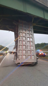 The bed of a dump truck lodged under I-64 overpass on Tuesday morning