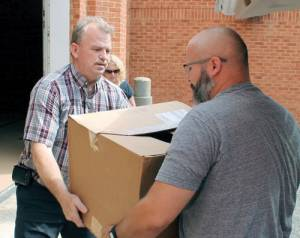 DSLCC staff member William Ould (left), collects donated items from Richie Crim, representing the faculty and staff at Lord Fairfax Community College in Middletown.