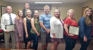 AP Program students and instructors for board are: Jeff Owens (left), instructor of AP U.S. Government and Politics and AP Psychology; Sarah Helmick, GEHS AP student; Olivia McCarty, GEHS AP student; Taylor Carter, GEHS AP student; James Floyd, GEHS AP student; Abigail Plum, GEHS AP student; Teresa Rowe, instructor of AP U.S. History; Sarah Stacy, GEHS AP student; and (Back Row) Shannon Brunzo-Hager, GWHS AP student.