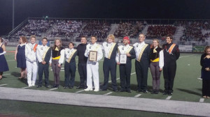 The Spartan Band's leadership team just after accepting their awards on Saturday evening. Drum major/field conductor John Ambler is shown holding the First Place in Class award while James Floyd is holding the Best General Effects award.