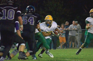 Running back Jaylon Battaile hits the hole for Greenbrier East in action last Friday night in Monroe County. James Monroe High School won the contest, 34-6. (Mark Robinson photo)