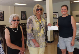 Mayor Andrea Pendleton (left) with City Bank representative Sandy Sorrell (center), as they congratulate Tammy Jordan upon reopening Fruits of Labor Cafe and Bakery after shop was damaged with four and a half feet of water from the June 23 flood disaster.
