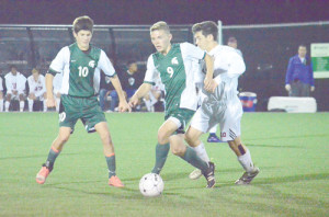 East's Scott Soucier moves the ball against Woodrow Wilson during the second half of their game Tuesday night. Woodrow won in overtime, 2-1. (Mark Robinson photo)