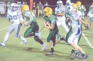 Logan Mandeville carries the ball for Greenbrier East's junior varsity football team during a game against Princeton Monday night. The Spartans won the game, 30-0. (Mark Robinson photo)
